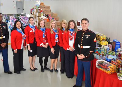 American Aero FTW Hosts Holiday Luncheon & Toy Drive To Benefit U.S. Marine Corps Reserve Toys for Tots Program
